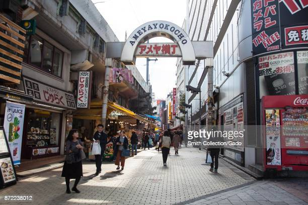 People walk down the Ameyoko Shopping Street a popular outdoor market area in the Taito ward of Tokyo Japan November 2017