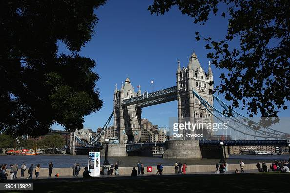 People walk down the River Thames near Tower Bridge on September 28 2015 in London England Warm weather is set to continue with temperatures...