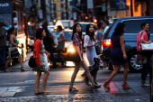 People walk down the street in SoHo during the fourth annual Fashion Night Out on September 6 2012 in New York City Fashion Night Out which launched...