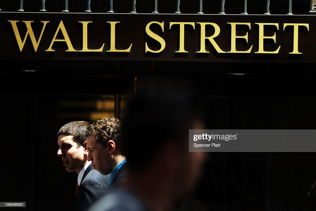 People walk down Wall Street on May 25, 2010 in New York City. The Dow Jones industrial average was down nearly 200 points in afternoon trading as fears continue about the European debt crisis and new fears of escalating tension between North and South Korea.