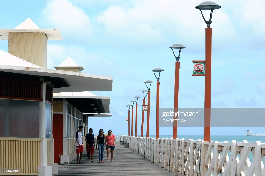 People walk in a British-style pier in Iracema beach, in Fortaleza, Ceara State, northeastern Brazil, on December 11, 2012. Fortaleza will host the Confederations Cup next June 2013, which will notably bring together four former world champions. AFP PHOTO / Evaristo SA