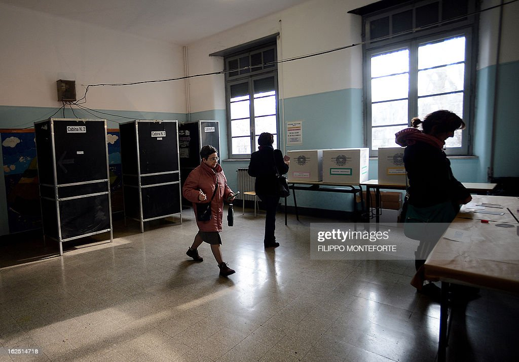 People walk in a polling station in Rome on February 24, 2013 during Italy's general elections. Italians fed up with austerity voted in the country's most important election in a generation, as Europe held its breath for signs of fresh instability in the eurozone's third economy.