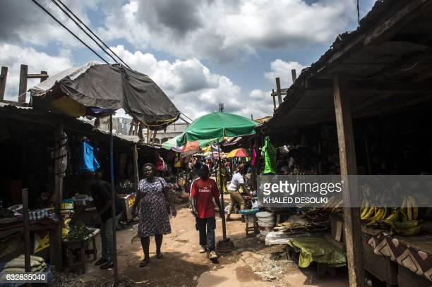 People walk in a public market in Franceville on January 27 during the 2017 Africa Cup of Nations in Gabon / AFP / KHALED DESOUKI