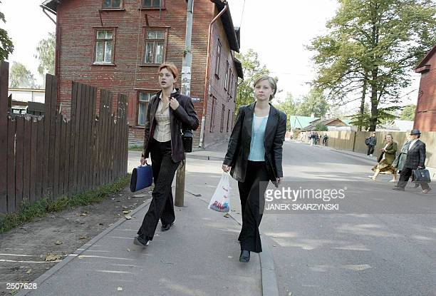 People walk in a street of Bouderia district Riga a former Russian military base mainly populated by Russians 18 September 2003 Out of the 23...