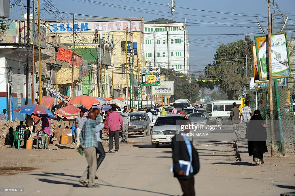 People walk in a street of Hargeisa on October 31 2012 AFP PHOTO / SIMON MAINA