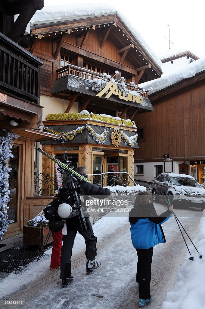 EMONET - People walk in a street of the French luxury ski ressort of Megeve, French Alps, on December 19, 2012. AFP PHOTO / JEAN-PIERRE CLATOT