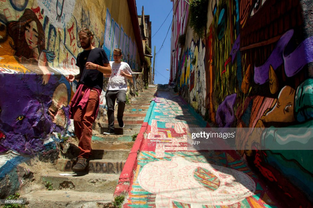 People walk in a street of Valparaiso Chile on January 14 2014 Valparaiso one of the most important South American ports on the Pacific Ocean was...
