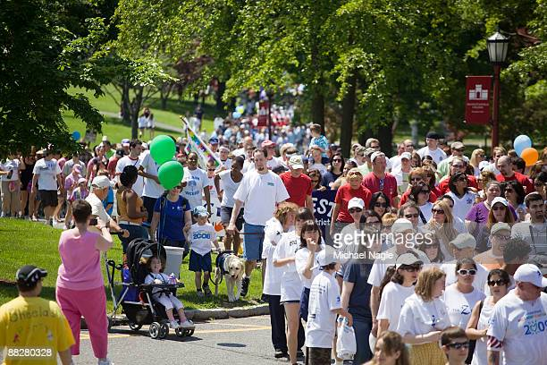 People walk in an autism awareness fundraiser sponsored by Autism Speaks at Manhattanville College on June 7 2009 in Purchase New York According to...