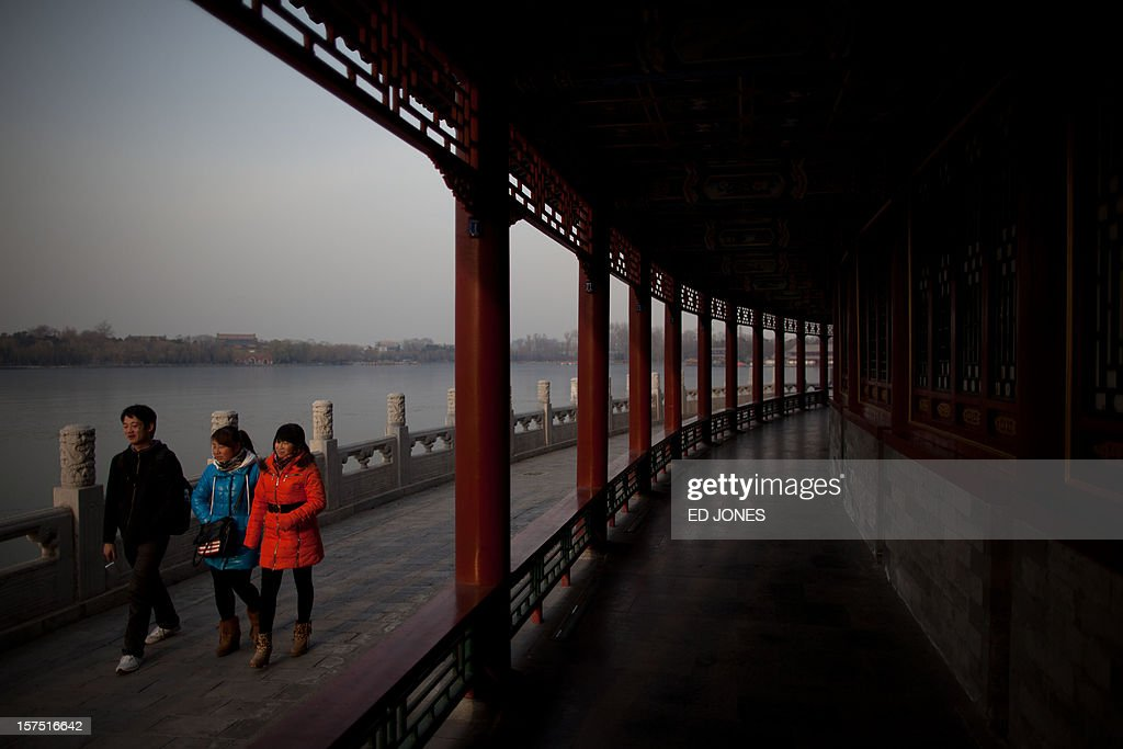 People walk in Beihai park in Beijing on December 4, 2012. The latest batch of purchasing managers' indexes from HSBC show manufacturing activity in China hit a 13-month high, while India also saw its strongest expansion since June. AFP PHOTO / Ed Jones
