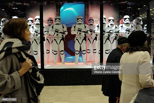 People walk in front of a Star Wars The Force Awakens inspired shop window at the Galeries Lafayette on November 19 2015 in Paris FranceOn November...