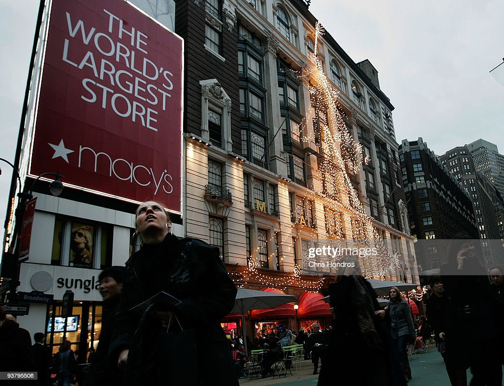 People walk in front of Macy's department store in midtown Manhatann December 3, 2009 in New York City. Retail sales declined 0.3 percent, with Macy's dopping 6.1 percent, in November, leading some analysts to fear that the holiday season will not live up to expectations.