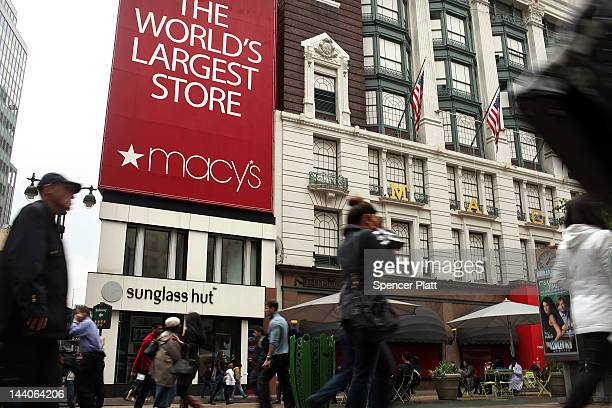 People walk in front of Macy's flagship store on May 9 2012 in New York City Beating Wall Street's expectations Macy's Inc reported a 38 percent...