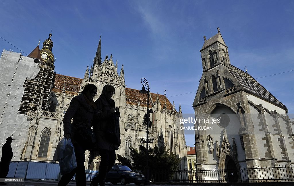 People walk in front of most famous landmark, the14th century St. Elisabeth Cathedral in Kosice on January 17, 2013. Eastern Slovakia's heavy industry hub Kosice is hoping to reinvent itself as a culture and creativity centre while it starts its year as the 2013 European Capital of Culture. Two-day opening ceremony featuring fireworks and gigs of world-famous and local artists this weekend will kick off a year of Kosice's transformation while giving a nod to its past. The European Union awards the title of the European Capital of Culture since 1985, usually to two cities a year to raise their international visibility. This year a French port city of Marseille was chosen along with Kosice. AFP PHOTO/SAMUEL KUBANI