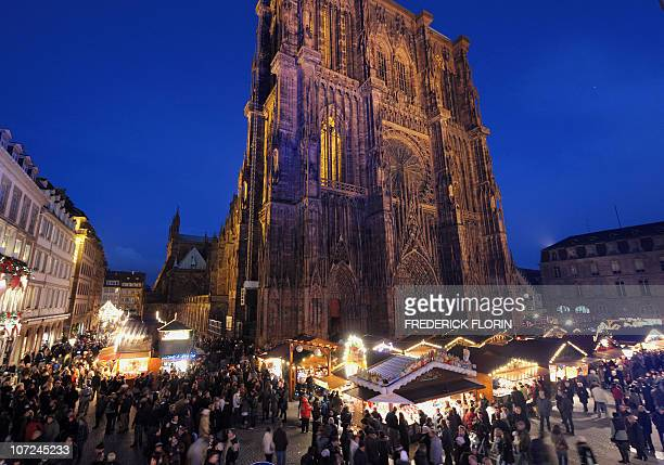 People walk in front of the Cathedral on November 27 2010 during the opening of the Strasbourg Christmas market which is the largest and one of the...