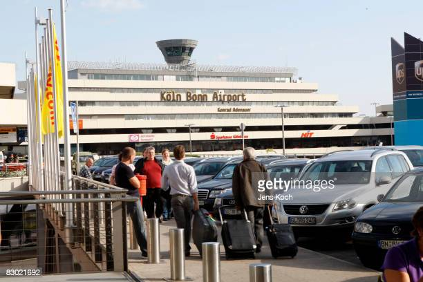 People walk in front of the CologneBonn airport on September 26 2008 in Cologne Germany In the morning two Somaliborn terror suspects were arrested...