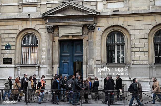 People walk in front of the facade of the Condorcet high school in Paris on December 21 2012 AFP PHOTO/JACQUES DEMARTHON