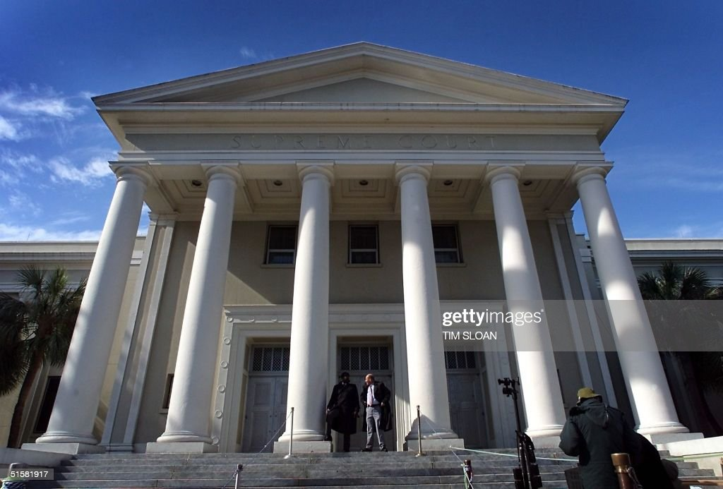 People walk in front of the Florida Supreme Court in Tallahassee 04 December 2000 The US Supreme Court has asked the Florida Supreme court to...