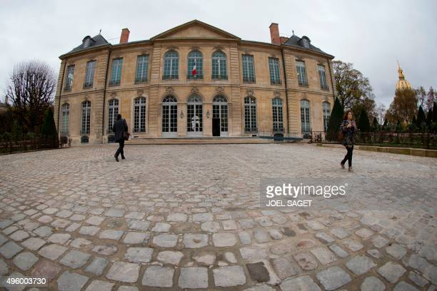 People walk in front of the Hotel Biron housing the Musee Rodin in Paris on November 6 days ahead of the museum's reopening After three years of...