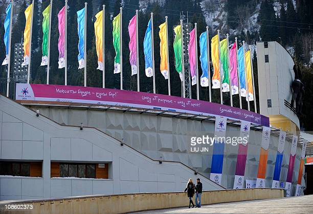 People walk in front of the Medeu Alpine Ice Arena during the 7th Asian Winter Games in Almaty on January 30 2011 The Asian Winter Games will be held...