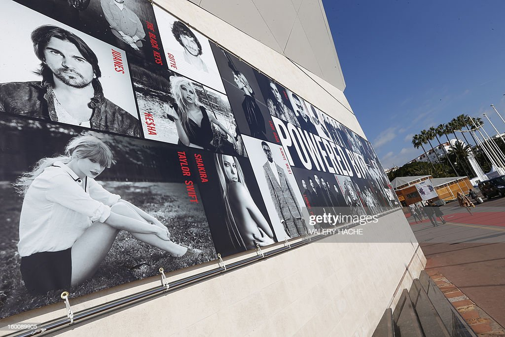 People walk in front of the Palais des Festivals, in Cannes, southeastern France, on January 26, 2013 on the opening day of of the music world's largest annual trade fair, Midem. The Midem music trade show brings 7,000 of the global industry's biggest players together on the French Riviera for four days.