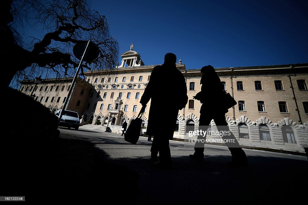 People walk in front of the Vatican government palace, the Palazzi del Governatorato at the Vatican City State on February 19, 2013. Pope Benedict XVI will be hosted in the convent of Mater Ecclesiae (Mother of the Church) offering him a substantial four-story modern home complete with contemporary chapel, garden and a roof terrace looking out from a rise dominated by the Holy See's TV transmission tower. Pope Benedict XVI began a week-long spiritual retreat out of the public eye on Monday ahead of his resignation on February 28 with the field of candidates to succeed him still wide open. AFP PHOTO/ Filippo MONTEFORTE