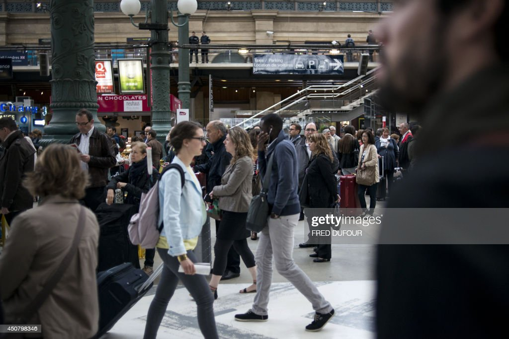 People walk in Gare du Nord train station in Paris on June 18 during a national strike by French SNCF railway company employees Tensions rose in...