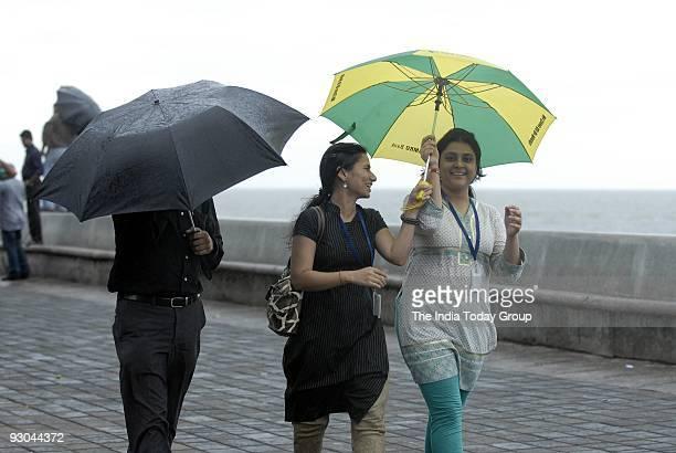 People walk in Mumbai's Marine Drive Cyclone Phyan passed by Mumbai without causing any damage on Wednesday November 11 2009