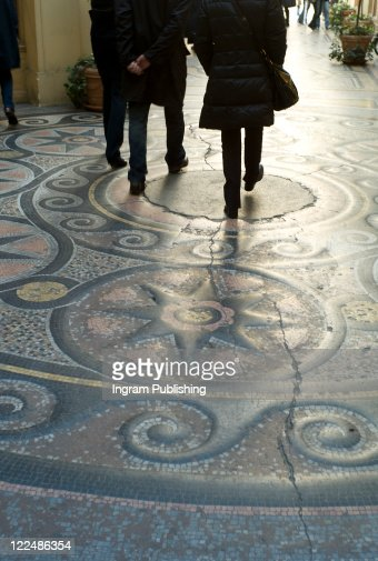 People walk in pedestrian arcade, low section, Paris, St Germain : Stock Photo