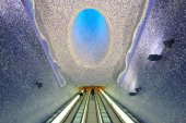 People walk in the 'Cathedral' with the Crater of Luz by artist Oscar Tusquet Blanca in the Toledo subway station as part of the 'Art Station Line 1'...
