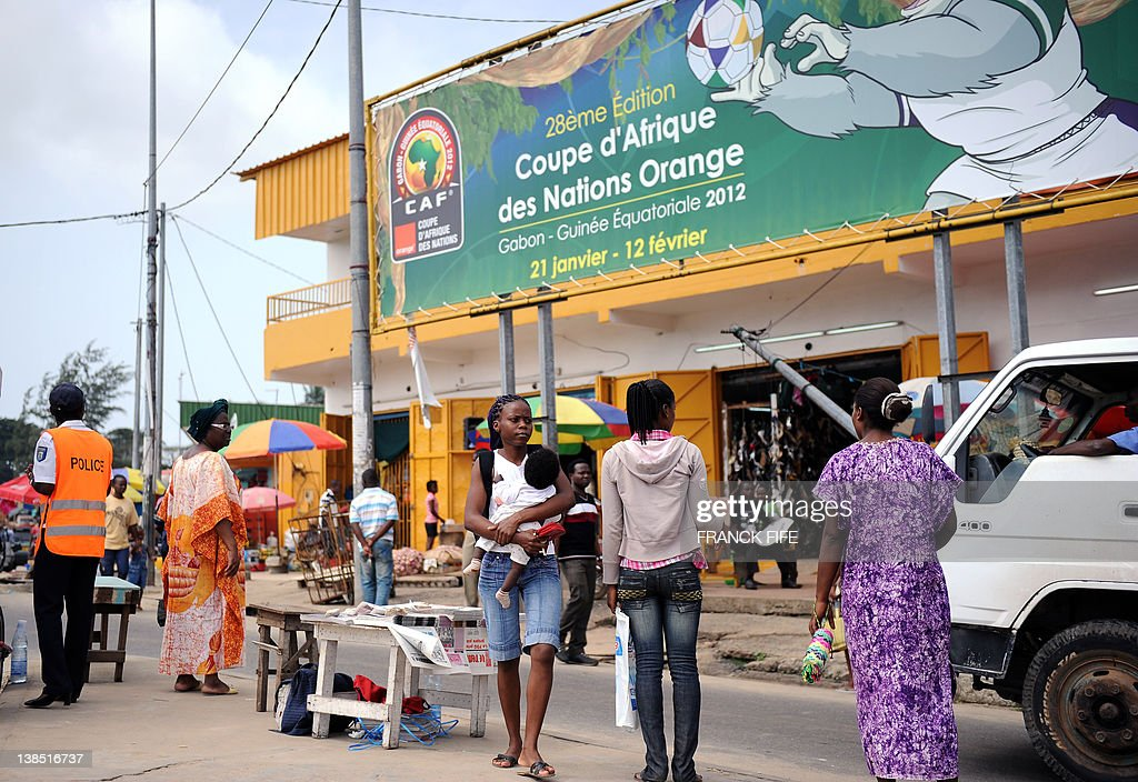 People walk in the center of Libreville before the African Cup of Nations semifinal football match Mali vs Ivory Coast on February 8 2012 AFP PHOTO /...