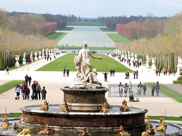 People walk in the gardens of the Chateau de Versailles on April 4 2010 in Versailles outside Paris The Palace of Versailles was the main residence...