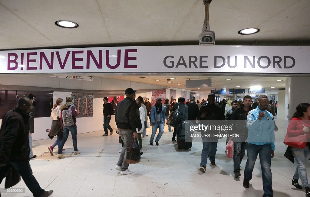 People walk in the Gare du Nord railway station in Paris on March 9 2015 on the first day of a strike called by the General Confederation of Workers...