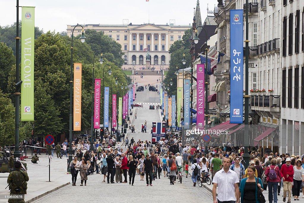 People walk in the main street of Oslo Karl Johans gate on July 23 a day after the twin attacks on a youth camp and the government headquarters that...