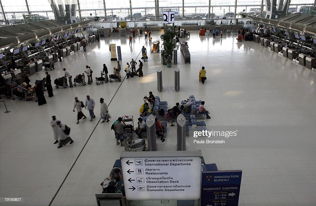 People walk in the main terminal at the new Bangkok Suvarnabhumi international airport January 30 2007 in Bangkok Thailand The new $4 billion airport...