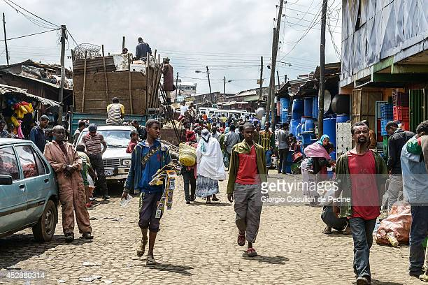 People walk in the market streets of Merkato district on July 04 2014 in Addis Ababa Ethiopia The Ethiopian government has recently launched a new...