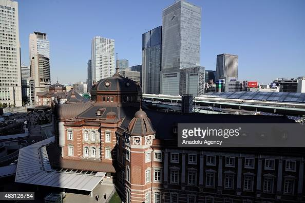 People walk in the middle of buildings of the financial and business of Tokyo Japan on February 10 2015 Japanese Prime Minister Shinzo Abe want to...