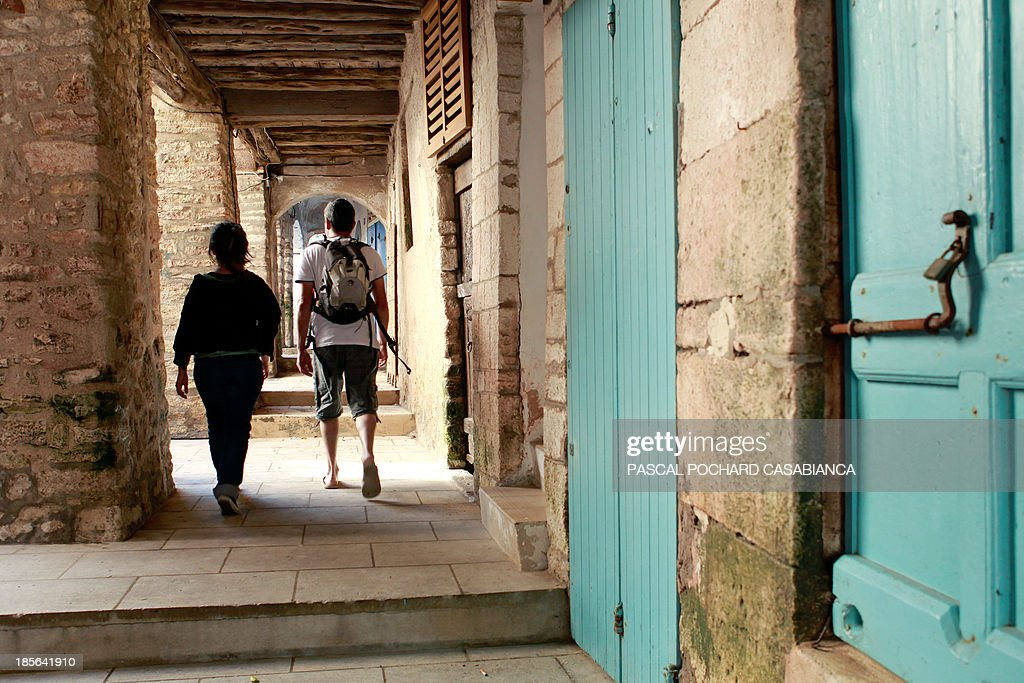 People walk in the old city of Bonifacio, France's southern Mediterranean island of Corsica, on October 22, 2013. Bonifacio is classified as one of France's most beautiful villages.