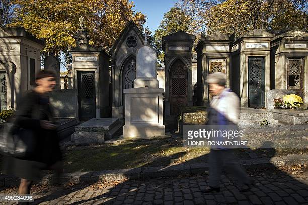 People walk in the Pere Lachaise cemetery on November 1 2015 in Paris during the AllSaints Day AFP PHOTO / LIONEL BONAVENTURE