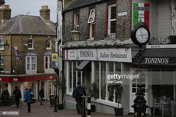 People walk in the shopping street in Cowes on January 7 2015 on the Isle of Wight England Tourism remains the most important part of the economy for...