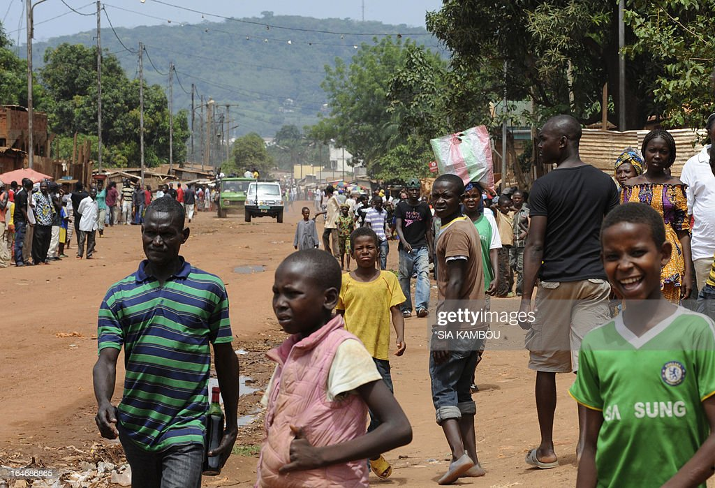 People walk in the srteets of Bangui on March 26, 2013. Central African Republic strongman Michel Djotodia was set to unveil a new government on March 26 after declaring he would rule by decree following the latest coup in the notoriously unstable nation. Looters were on the rampage in the capital Bangui after Djotodia's Seleka rebel coalition seized control in a rapid-fire weekend assault that forced president Francois Bozize into exile and was condemned by the international community.