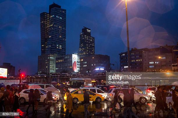 People walk in the street in front of Trump Towers Istanbul on November 29 2016 in Istanbul Turkey US Presidentelect Donald Trump has come under...