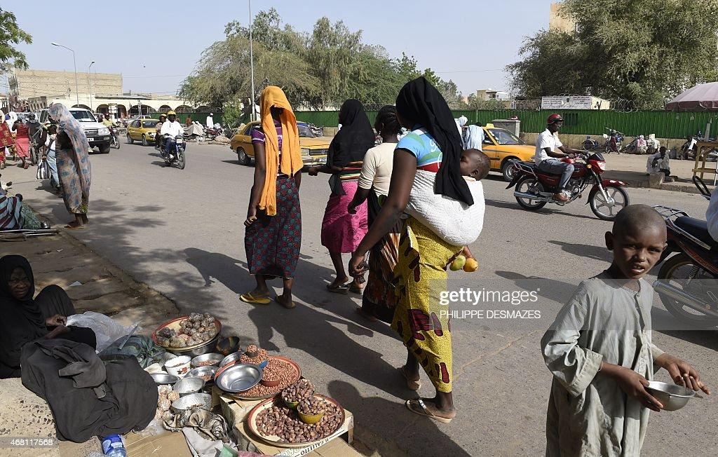 People walk in the street near a market in N'Djamena on March 30 2015 AFP PHOTO / PHILIPPE DESMAZES