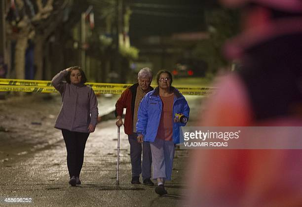 People walk in the streets of Concon some 110 kms northwest of Santiago after a large earthquake on September 16 2015 The 83magnitude earthquake that...
