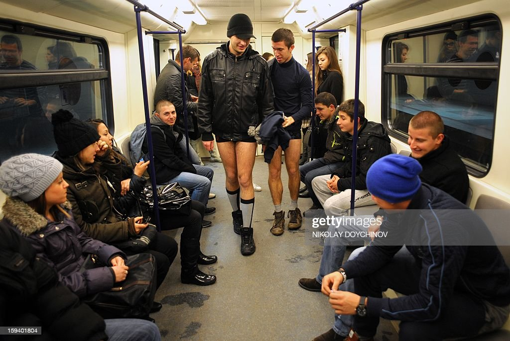 People walk in underwear in the Sofia City subway as they take part in the 2013 No Pants Subway Ride on January 13, 2013. The No Pants Subway Ride, in its 12th year, still surprises passengers on public transit and is spreading to many cities across the globe. AFP PHOTO / NIKOLAY DOYCHINOV