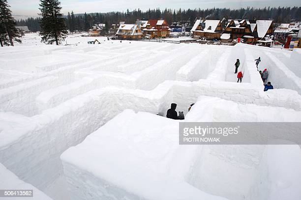 People walk inside a snow maze built with 60 thousand ice cubes aimed at beating the Guinness world record on January 23 2016 in Zakopane / AFP /...