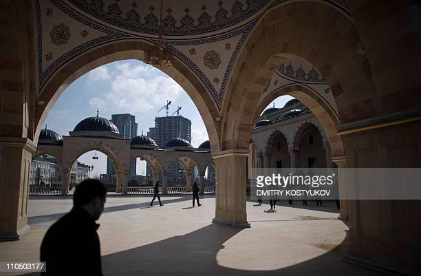 People walk inside Grozny's main mosque on March 7 2011 AFP PHOTO / DMITRY KOSTYUKOV