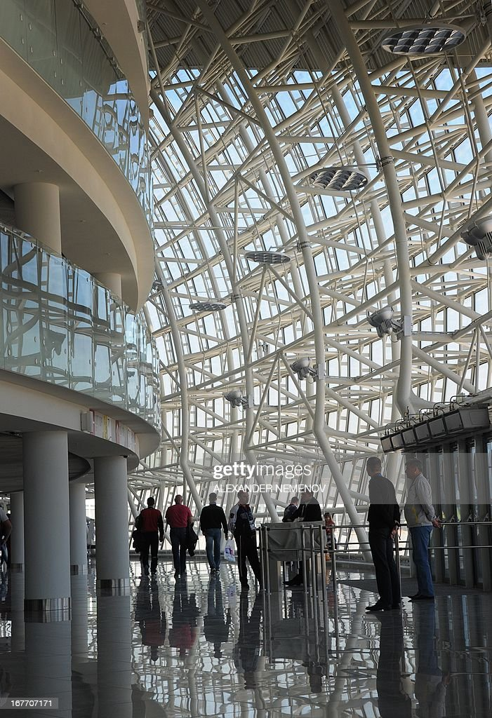 People walk inside the Bolshoi Ice Dome arena - ice hockey venue at the Olympic Park in Adler outside Sochi, during the IIHF U18 International Ice Hockey World Championship on April 28, 2013.
