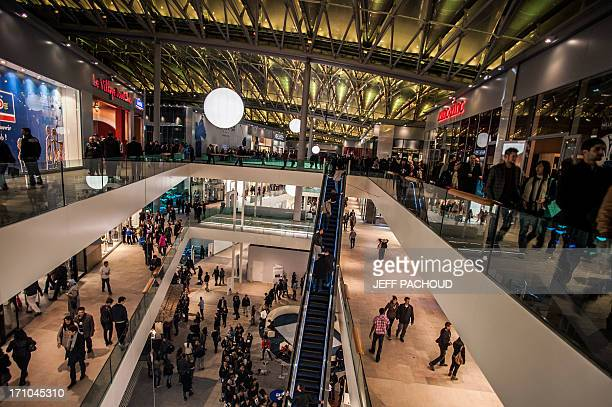 People walk inside the Confluence shopping centre on April 4 2012 in Lyon on the day of it's inauguration AFP PHOTO / JEFF PACHOUD