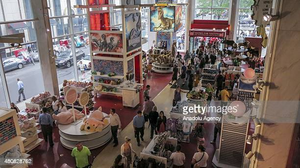 People walk inside the iconic toy store FAO Schwarz in New York during its last day in business on July 15 in New York City The 153yearold store...