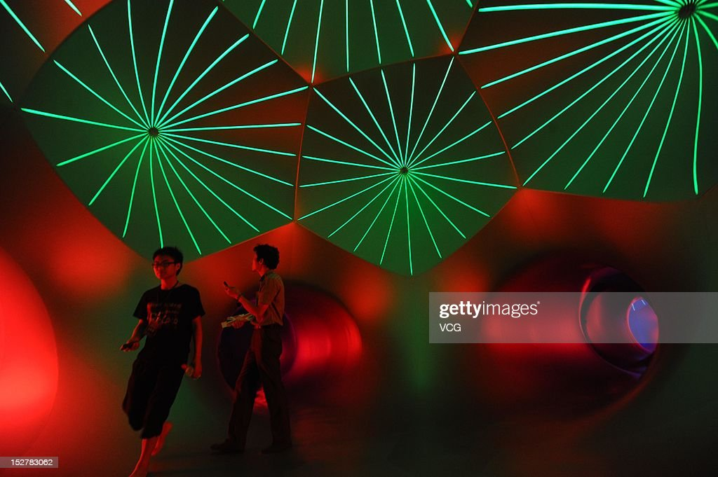 People walk inside the Miracoco Luminarium, an inflatable sculpture by British artist Alan Parkinson of Architects of Light, at Evergreen Garden during 'UK Now', the biggest ever festival of British arts and creative industries in China, on September 26, 2012 in Wuhan, China.